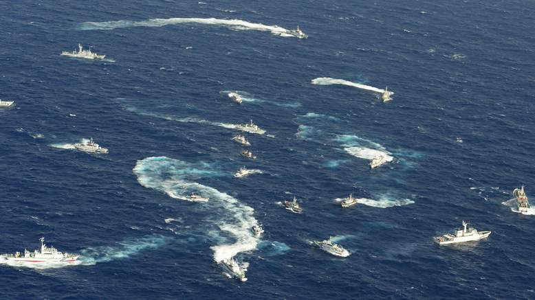 Fishing boats from Japan, Taiwan and mainland China regularly visit the waters surrounding the disputed, in an effort to underline their respective home country's claim on the islands and their waters. Here we see a complex skirmish between numerous fishing boats, and almost as many maritime patrol boats (this is most likely Chinese fishing boats being herded by Japanese patrol boats).