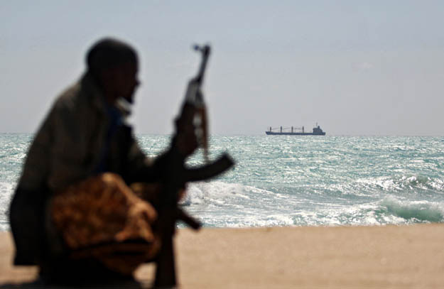 A Somali pirate poses