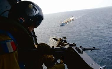 Somali pirates remain active, even though reported incidents are down sharply since mid-2102. Part of that is due to under-reporting of piracy both by armed guards protecting merchant vessels (when they use their weapons to warn off suspicious boats, they increasingly opt not to report the incident, so as to avoid any potential liability), as well as by shipowners (who in the hypercompetive market where too many ships are chasing too few charters, fear having news of one of their ships being targeted by pirates lead to potential or actual clients to shun them). Here we see a French military man operating a machinegun from a helicopter on patrol over sea lanes near Somalia. The continued presence of warships, helicopters and even unmanned reconnaissance aerial vehicles is needed.