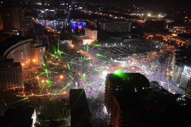 Pursuant to General al Sisi's call for massive peaceful protests against violence and terrorism, on Friday July 26 millions of Egyptians showed up. Here we see Tahrir square. The green lights are lasers that the demonstrators started using on June 30th. American built Apache helicopters flew over the crowd and were cheered by the crowds, who painted the copters with their lasers. Other protests later that night weren't as jovial or peaceful: pro-Morsi protestors tried moving over to a bridge and the worst violence so far occurred since the military intervened.