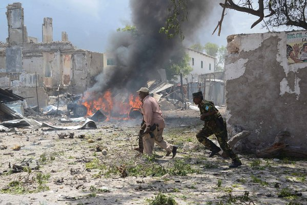 Despite all the encouraging news from Mogadishu since late 2012, al Shabaab, the al Aqaeda-affiliated Islamist insurgent group has not put down it arms. As it's been pushed out of major cities and towns, it has moved from conventional combat over to terrorist attacks and asssasinations. Here we see the authorities responding to an especially heinous and bloody attack on a courthouse, which involved almost a dozen attackers and which cost the lives of at least 20 innocent people.
